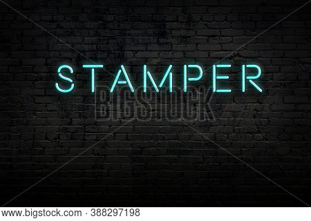 Neon Sign On Brick Wall At Night. Inscription Stamper