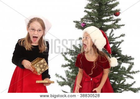 Two girls happy with their holiday gifts