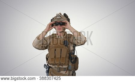 Soldier Preparing Tactical Gear For Action Battle On Gradient Ba