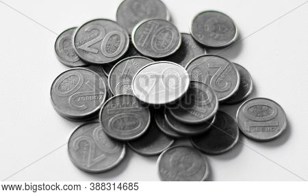 Pile Of Silver Coin, Copper Coin, Quarters, Nickels, Dimes, Pennies, Fifty Cent Piece And Dollar Coi