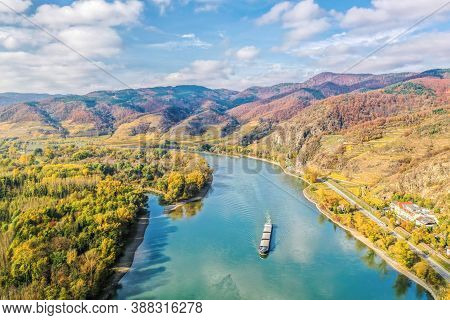 Panorama Of Wachau Valley With Ship On Danube River During Autumn In Austria
