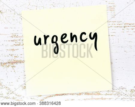 Yellow Sticky Note On Wooden Wall With Handwritten Inscription Urgency