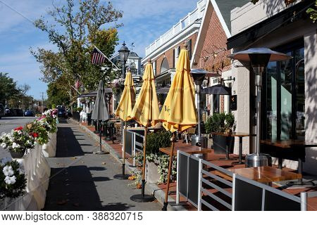 NEW CANAAN, CT, USA - OCTOBER 4, 2020: Elm Street view with restaurants in New Canaan downtown during COVID-19 pandemic