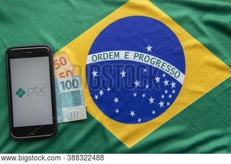 Florianopolis, Brazil. 28/09/2020: Top View Of Pix Logo On Smartphone Screens On Brazilian Flag And