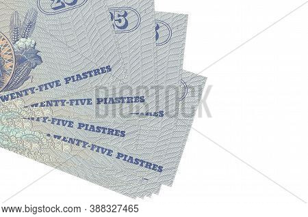 25 Egyptian Piastres Bills Lies In Small Bunch Or Pack Isolated On White. Mockup With Copy Space. Bu