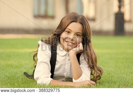 Mental Wellness. Girl School Uniform Enjoy Relax. Importance Of Relaxation. Little Schoolgirl. Relax
