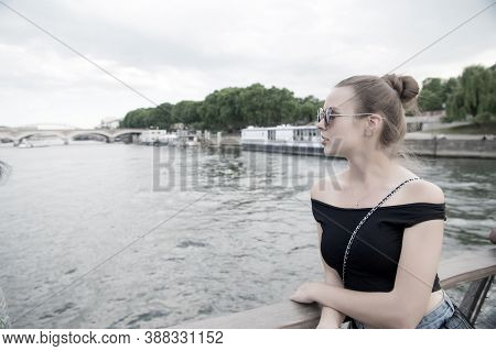 Woman Look At Seine River In Paris, France. Sensual Woman In Sunglasses On Bridge On Summer Day. Vac