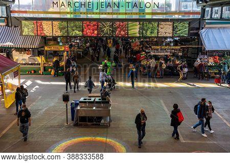 Montreal, Ca - 4 October 2020: Main Alley Of Marche Jean Talon Market With People Wearing Coronaviru