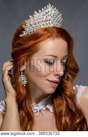 Portrait Beautiful Young Redhead Woman Wearing Crystal Crown Isolated On Grey Background Looking At