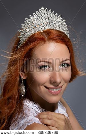 Adorable Redhead Woman Wearing Crown Smiling, Laughing Looking At You Camera Happy. Caucasian Person