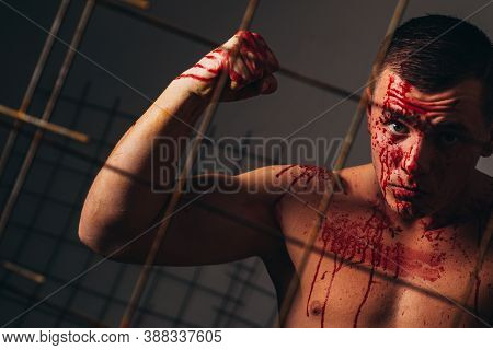 Murderer Brutal Aggressive Guy. Halloween Concept. Aggressive Person. Injured Soldier. Pain And Inju