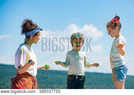 Little Kids With Colorful Paint. Group Of Children Enjoying Playing With Colored Powder And Color Du