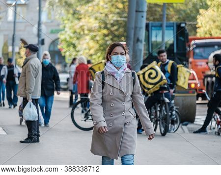 Moscow. Russia. October 4, 2020. A Woman Wearing A Protective Medical Mask Walks Through The City. S