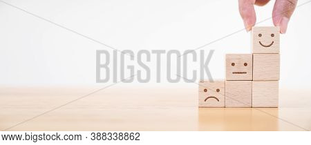 Hand Chooses Smiley Face Growth On Wood Block Cube, The Best Excellent Business Services Rating Cust