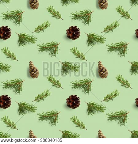 Seamless Christmas Pattern From Pine Cones And Pine Twig On Green Background. Modern Pine Cone Patte