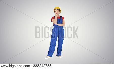 Woman In Construction Uniform Listening To Instructions On Gradi