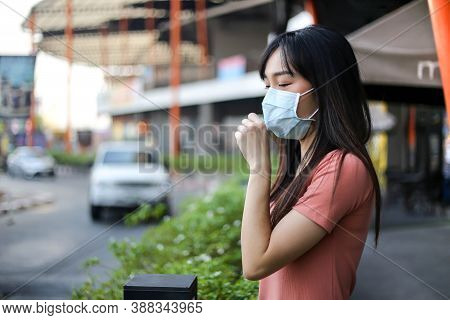 Beautiful Asia  Woman Suffer From Sick And Wearing Face Mask  Protect Filter Against Air Pollution (