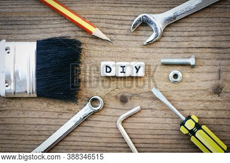Diy Tools Concept / Working Tools With Wrench Screwdriver Nuts And Bolts Paint Brush And Diy Blog On