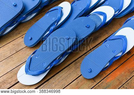 Blue And White Flip Flop On Wooden Background / Slippers Flipflops