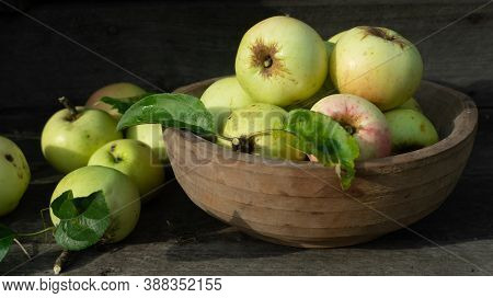 Green Organic Healthy Apples In Bowl On Wooden Board. Healthy Food