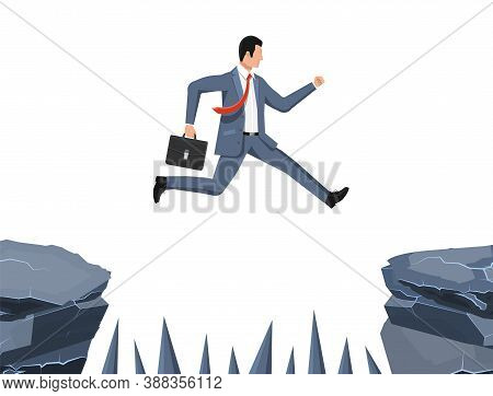 Businessman Jumps To Goal Through Abyss With Thorns. Business Man In Suit With Briefcase Jump Betwee