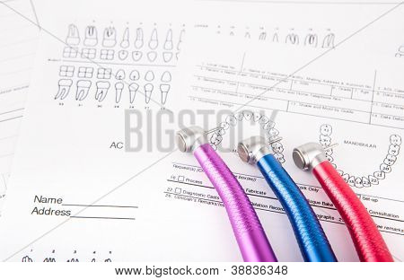 Dental tools and equipment on dental chart