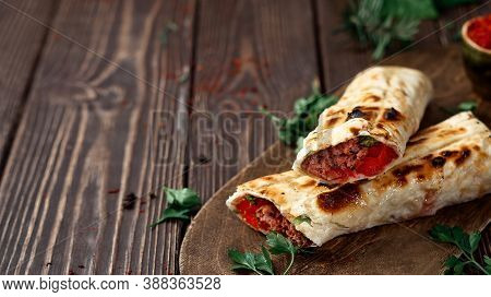 Traditional Turkish Shish - Adana Kebab, Shish Kebab With Tomatoes On Pita Bread With Vegetables And