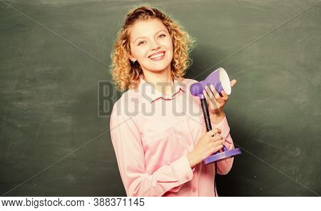 Proper Light Classroom. Light Up Process Of Studying. Teacher Woman Hold Table Lamp Chalkboard Backg