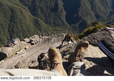 Machu Picchu, Peru - April 6, 2014: First Person View Of The Landscape Surrounding Huayna Picchu, Pe