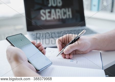 Remote Job Search At Home. Man Appoints Interview For Vacancy In Mobile Phone, Types Meeting Date In
