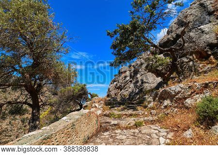 Greek Landscape. Paved Stairs, Hills, Mountains, Bushes. Olive, Mastic Trees. Clear Blue Sky, Beauti