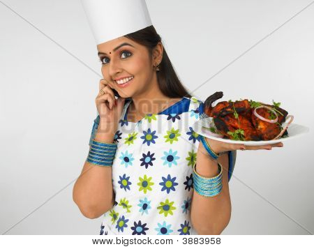 Asian Female Chef Talking On Her Cell Phone