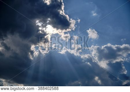Storm Clouds In A Dramatic Sky With Breaking Rays Of The Sun, Background