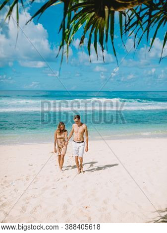 January 28, 2020. Bali, Indonesia. Couple At Tropical Ocean Beach. Honeymoon In Paradise Island