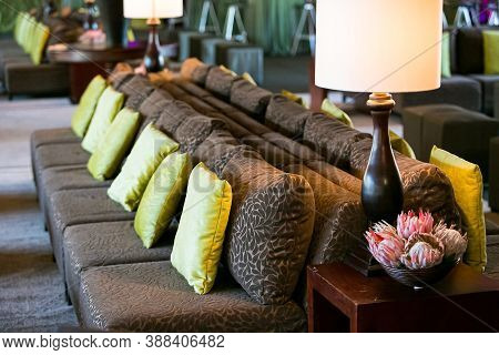 Comfy Couches And Flower Arrangement At Corporate Party Event