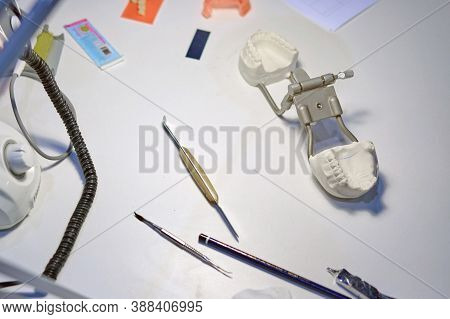 Dentist's Tools And A Dental Impression On The Table Of The Prosthetist's Doctor, Background
