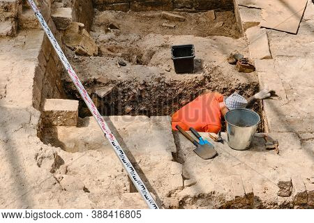 An Archaeologist Is Excavating An Ancient Building. Archaeological Work On The Excavation Of Monumen