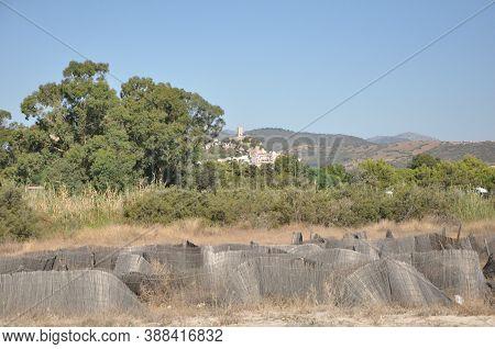 Posada- Beautiful Hill Top Village In Sardinia With Castello Della Fava On The Top. Location: Posada