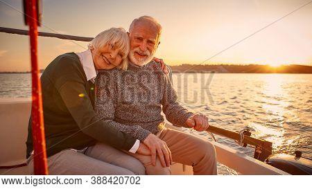 Enjoying Amazing Sunset. Happy Senior Couple, Elderly Man And Woman Holding Hands, Hugging And Relax