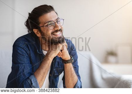 Portrait Of Smiling Indian Man With Eyeglasses And Braces In Home Interior, Handsome Pensive Western
