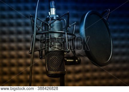 Microphone Close - Up On The Background Of A Professional Recording Studio. Workplace Singers And Mu