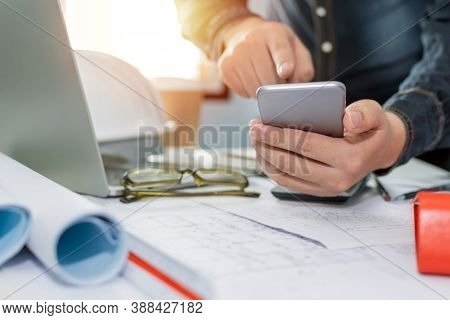 Engineer, Architect Or Interior Designer Calculate, Planning And Working On Blueprint On Desk In Mee