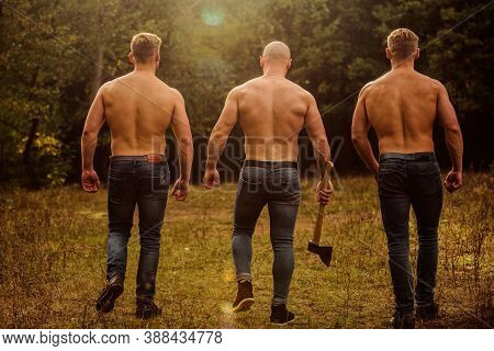Brutal Macho Style. Strong Men Nature Background. Inspiring Training Harder. Group Muscular Men With