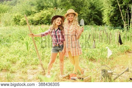 Growing Vegetables. Hope For Nice Harvest. Girls Planting Plants. Rustic Children Working In Garden.