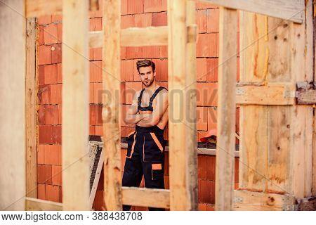 Perform Basic Tasks. Masculinity Concept. General Maintenance Repair Worker. Handsome Man Wear Overa