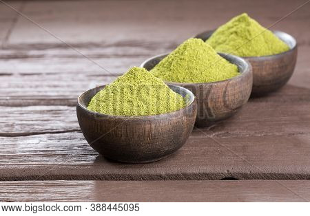 Natural Green Powder Sweetener - Stevia Rebaudiana. Wooden Background