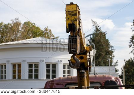 Small Truck With Loader Crane For Unloading Construction Materials At A Construction Site. Roadwork