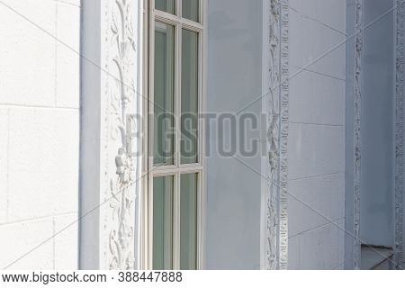 A White Floral Plaster Relief On A White Plastered Wall, Bas-relief With Stucco Mouldings Roccoco El
