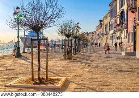 Venice, Italy, September 13, 2019: People Tourists Are Walking Down Embankment Promenade Fondamenta