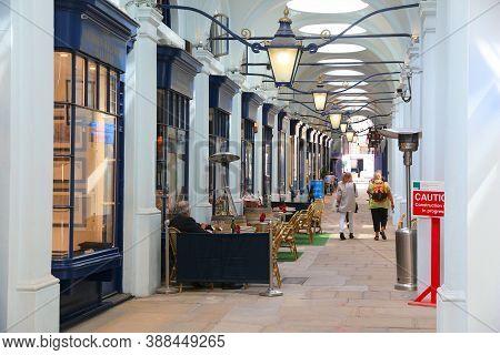 London, Uk - July 7, 2016: People Shop At Royal Opera Arcade In London. The Prestigious Royal Opera